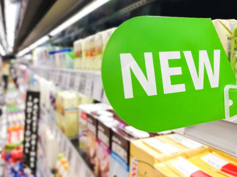 New word signage on supermarket shelf for new product arrival